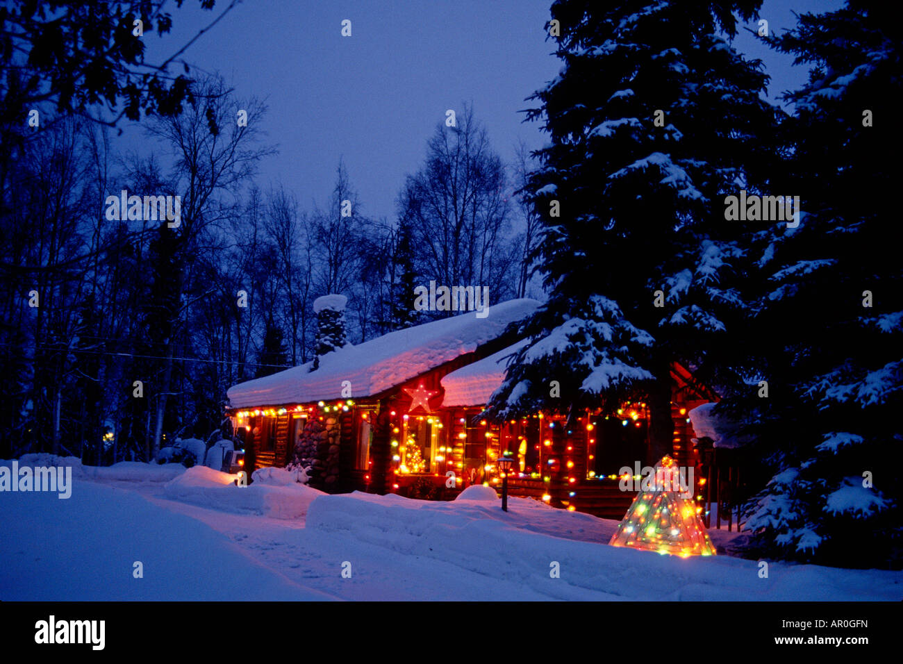 anchorage log cabin with christmas lights ak southcentral winter stock