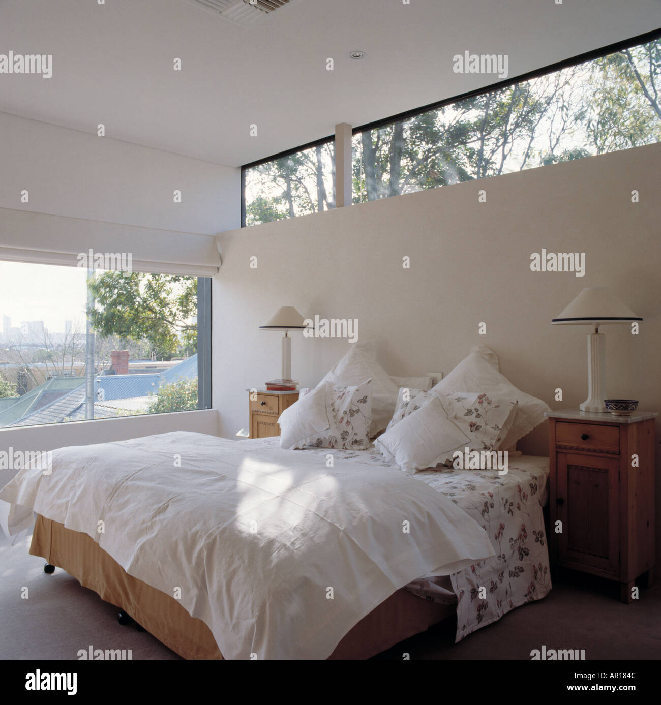 Narrow Window Above Bed With White Pillows And Quilt In Light And Stock Photo Royalty Free