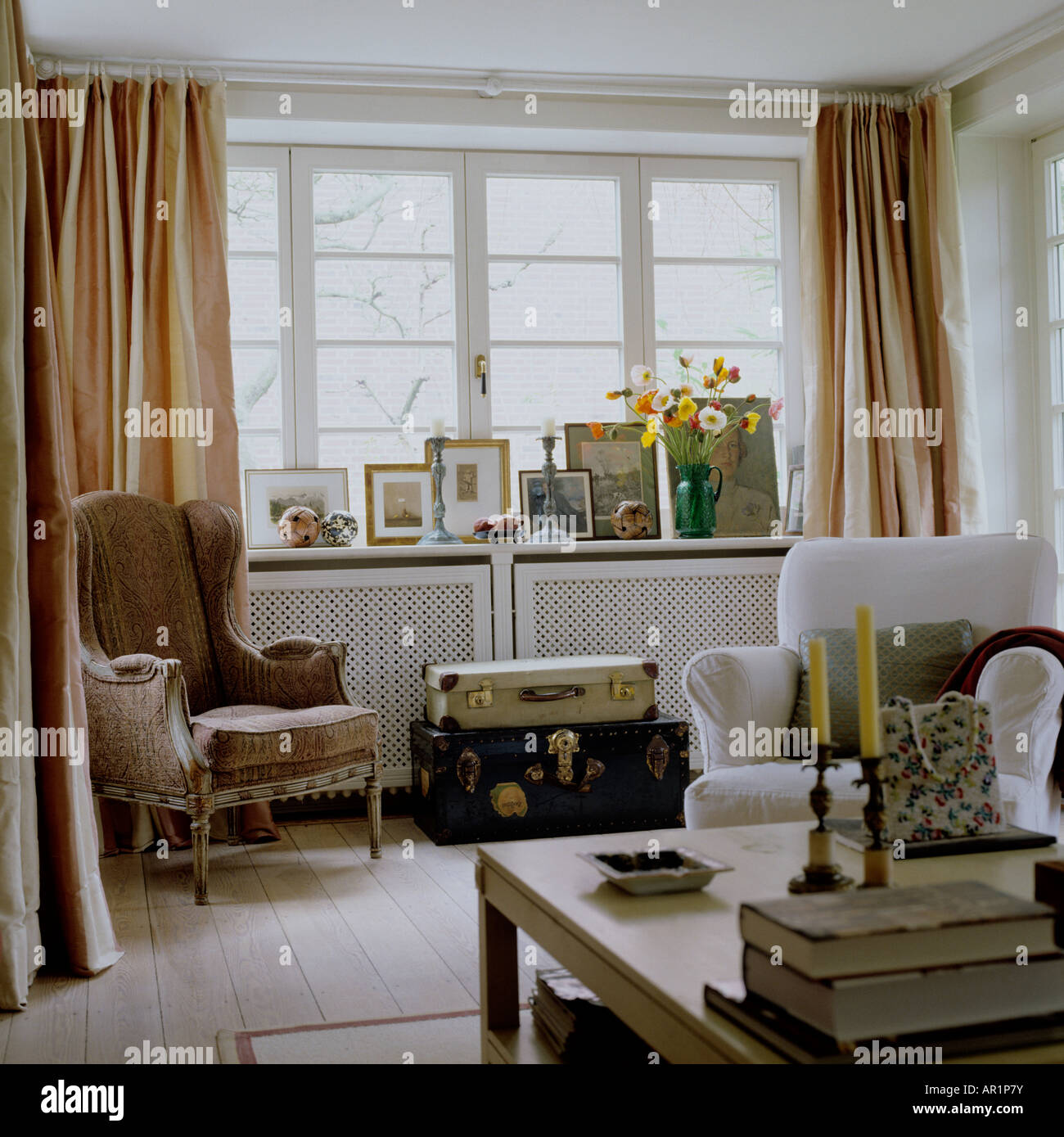 Stock Photo   Sitting Room With Armchairs, Coffee Table And Old Luggage As  A Side Table