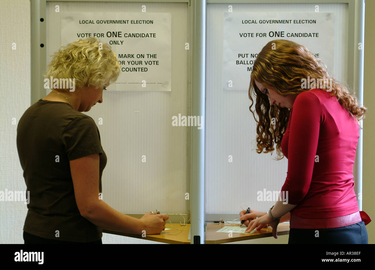 people-vote-women-voting-booth-votes-for