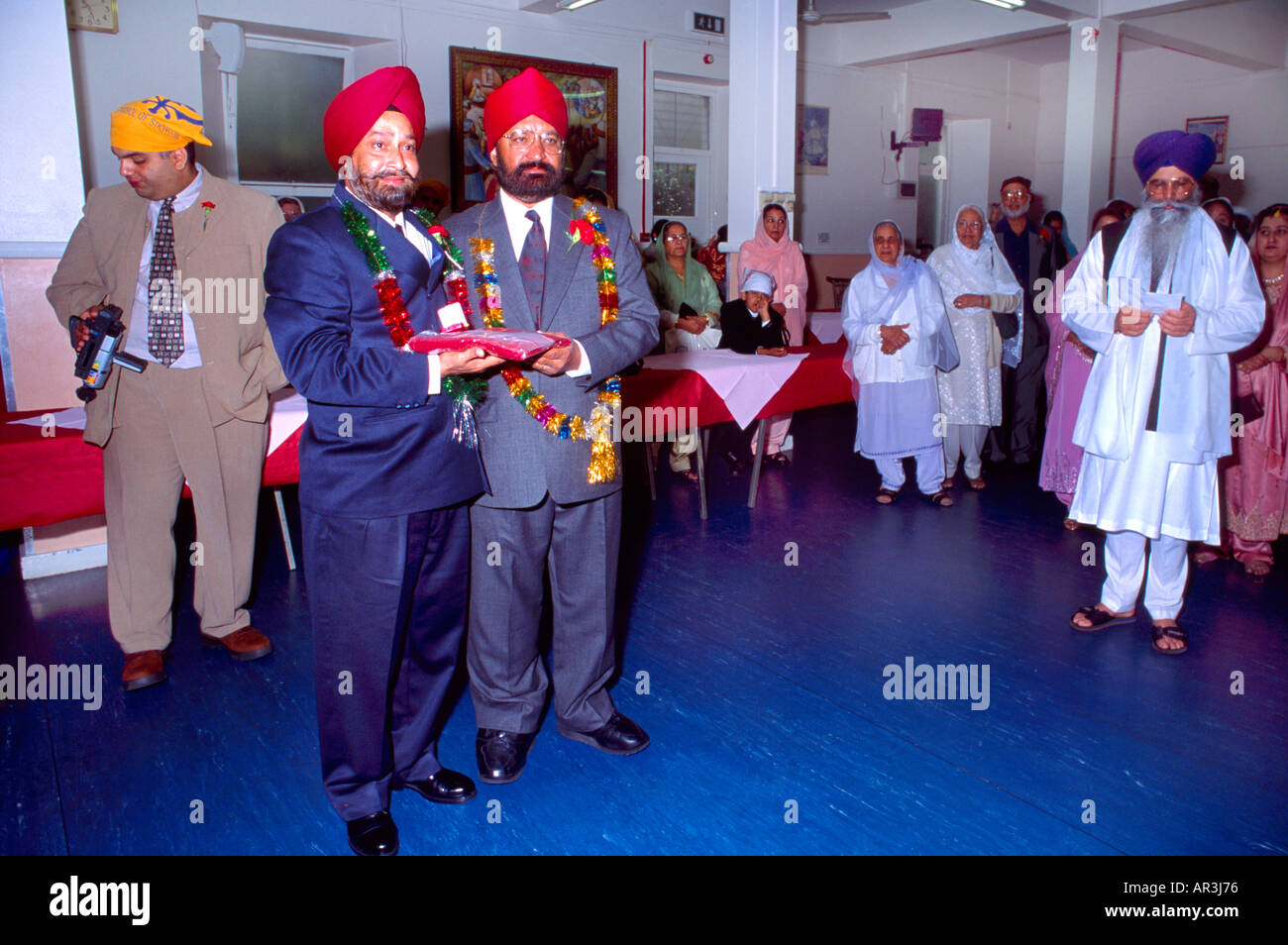 Sikh Wedding Family Members Exchanging Gifts Garlands Before Central Gurdwara Shepherds Bush London England