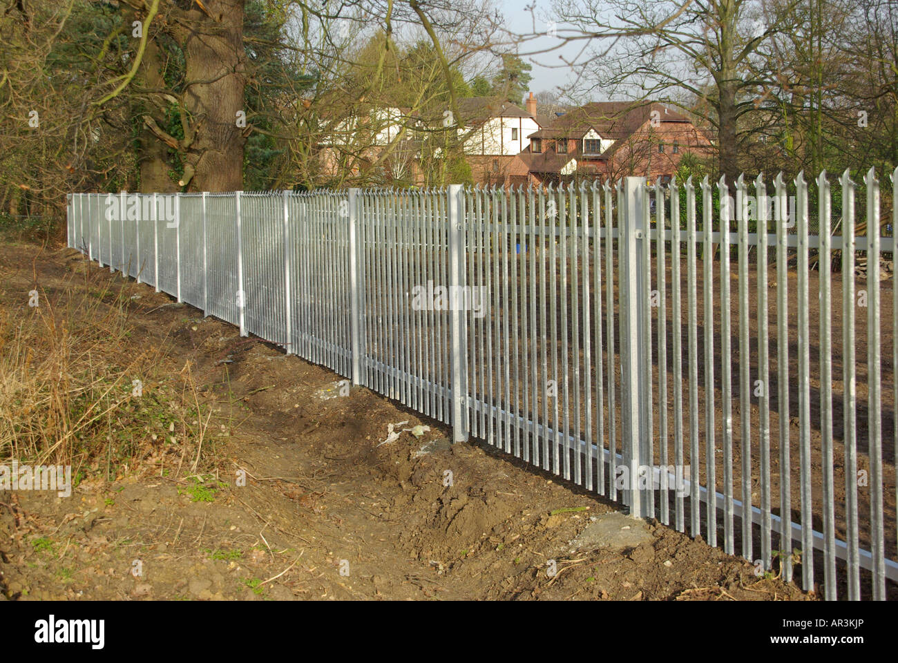 Marvelous photograph of Galvanised Steel Palisade Fence Panels Around Paddock Stock Photo  with #8E703D color and 1300x960 pixels