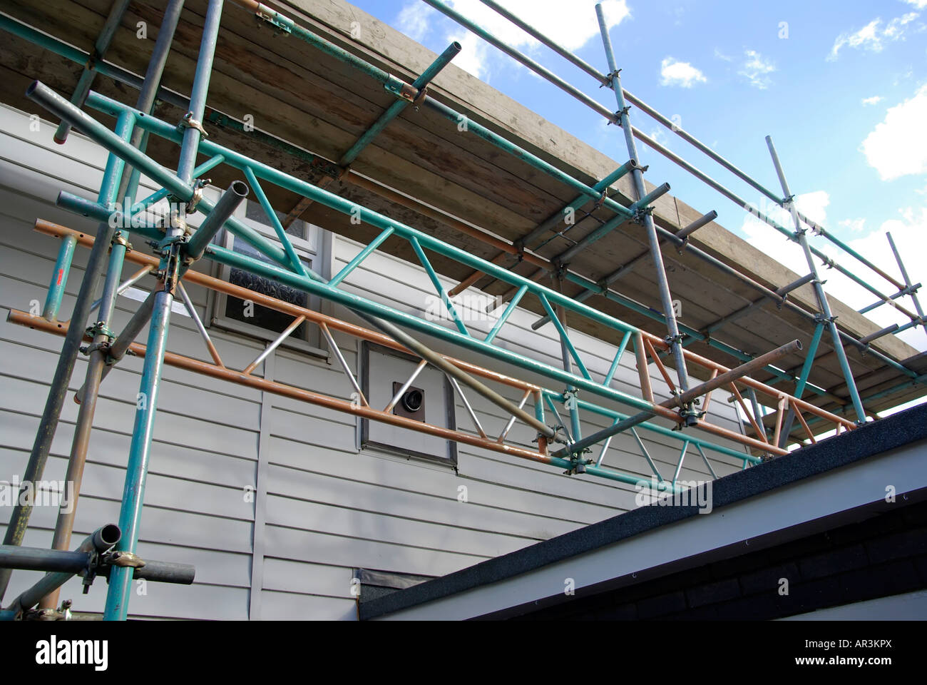 Roof Scaffolding Products : Scaffold erected around detached house for access to roof