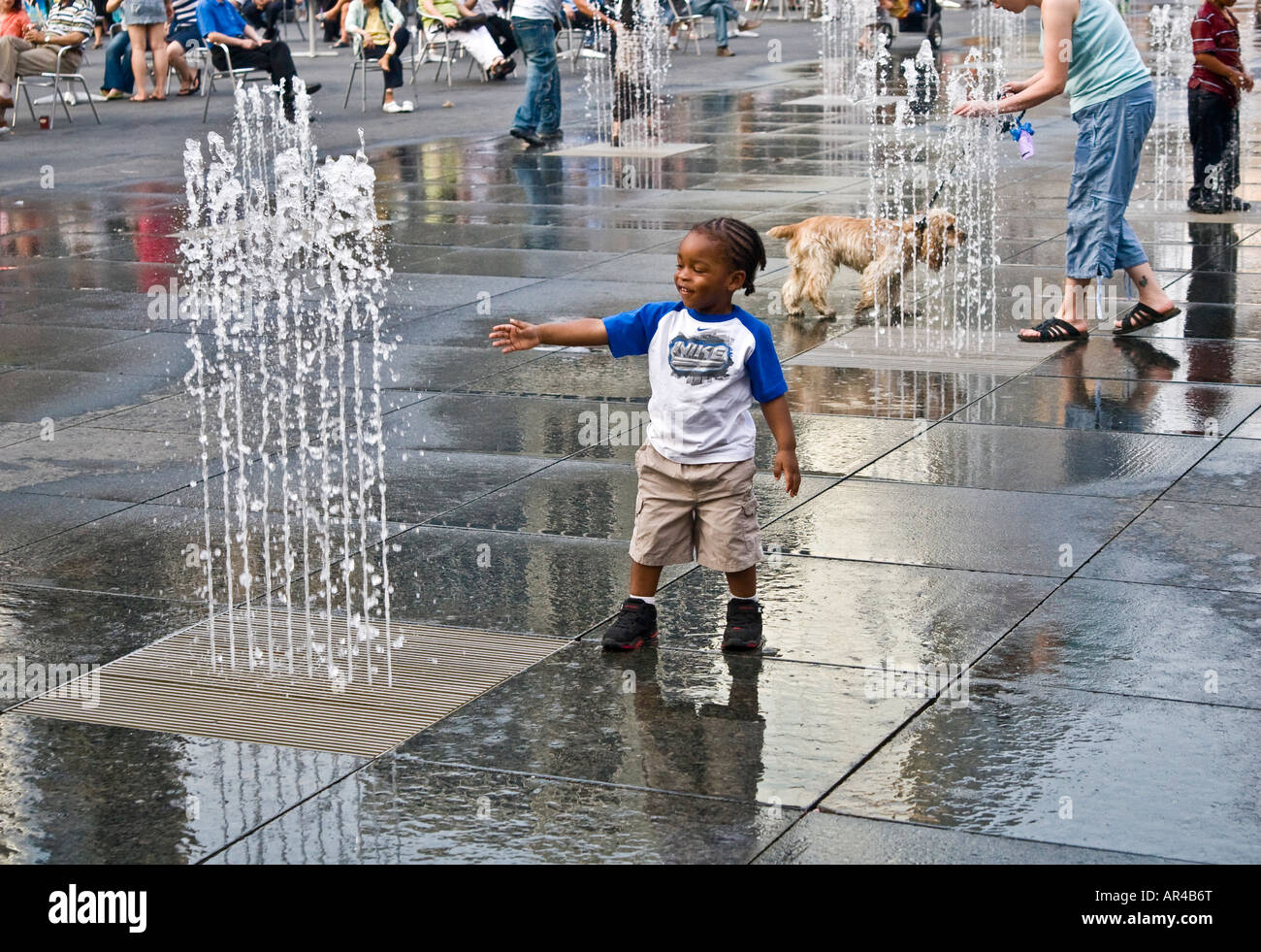 Water fountains canada - Little Boy Playing With Water Fountain Dundas Square Toronto Canada