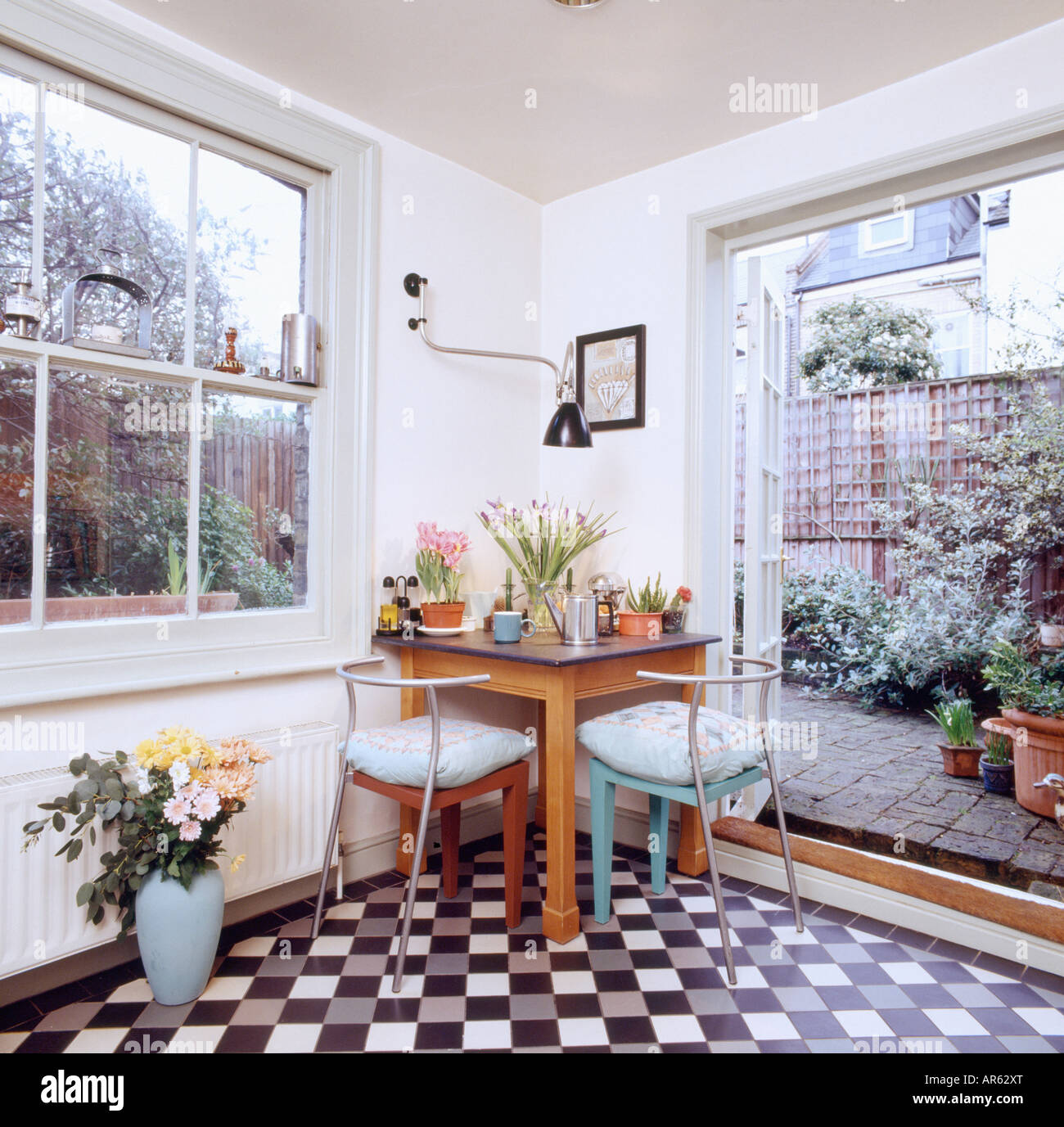 black and white tiled floor in small dining room extension with