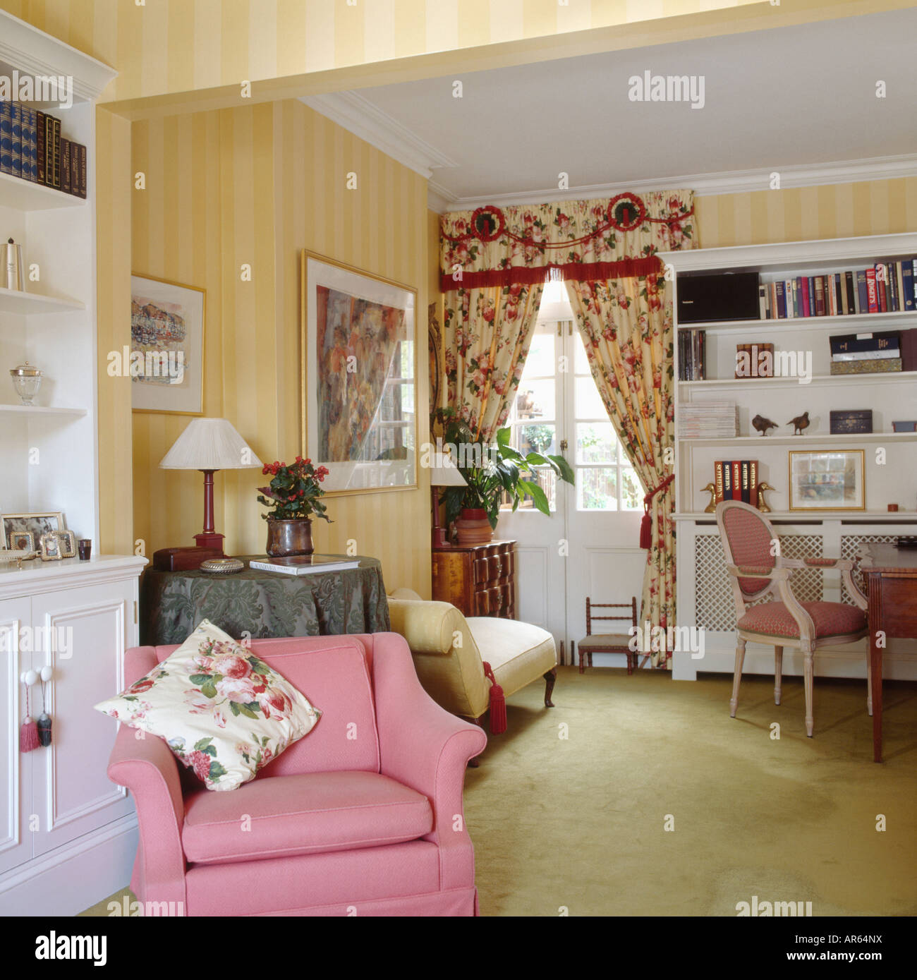 Red patterned curtains living room - Stock Photo Striped Yellow Wallpaper And Pink Armchair In Living Room With Patterned Red Curtains And Pale Green Carpet