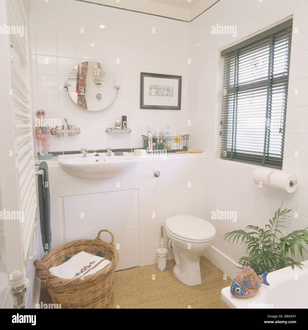 Stock Photo   White Built In Basin In Vanity Unit In Small White Bathroom  With Black Slatted Blind And Sisal Carpet And Basket Of Towels Part 46