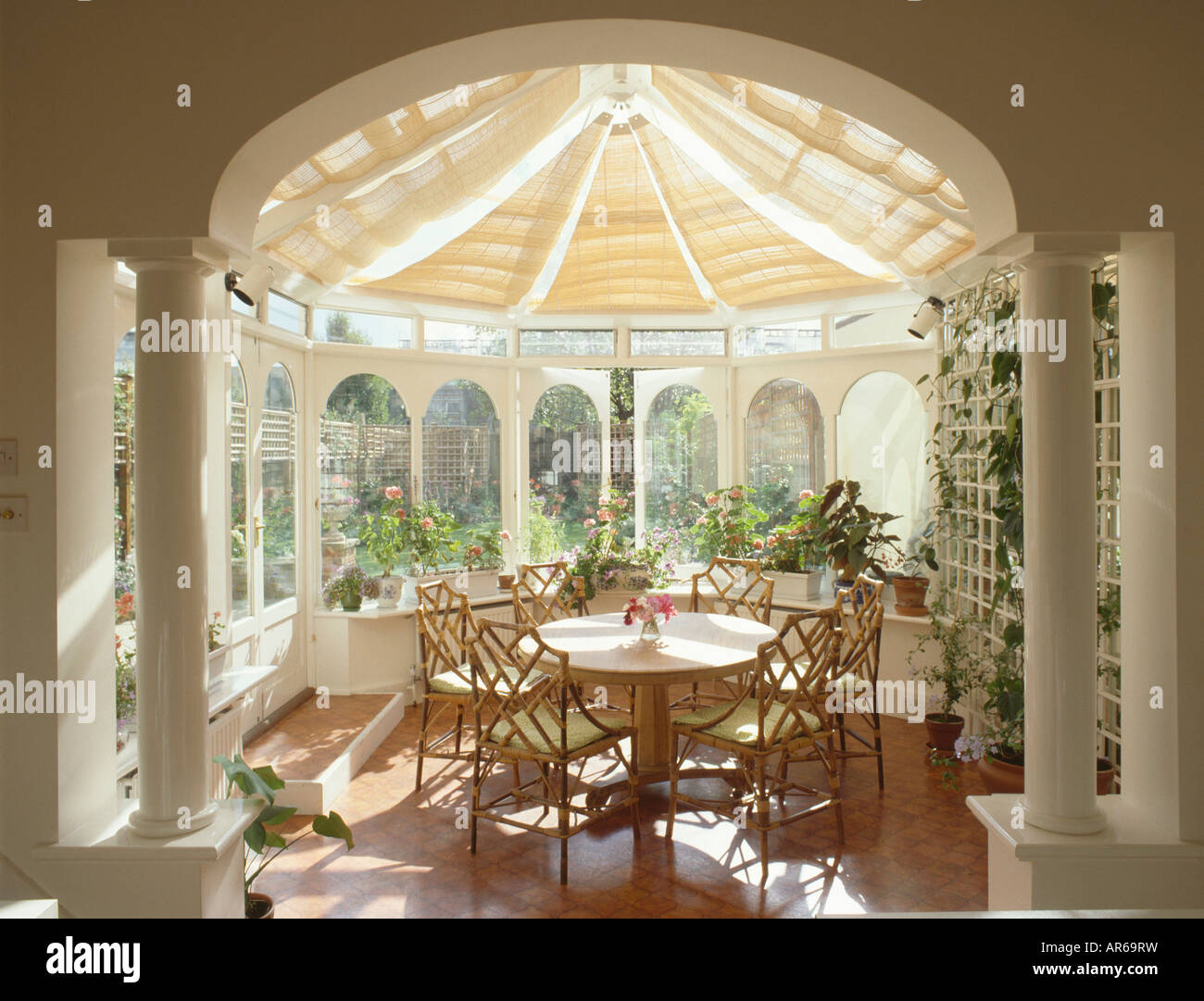 classical pillars in conservatory dining room with split. Black Bedroom Furniture Sets. Home Design Ideas