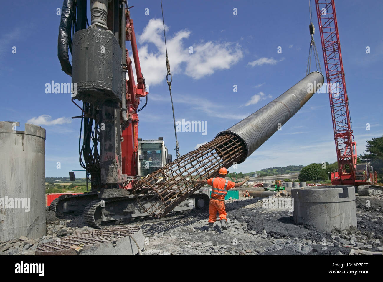 Crane Lifting Steel Reinforced Cage Into An Excavated Pile