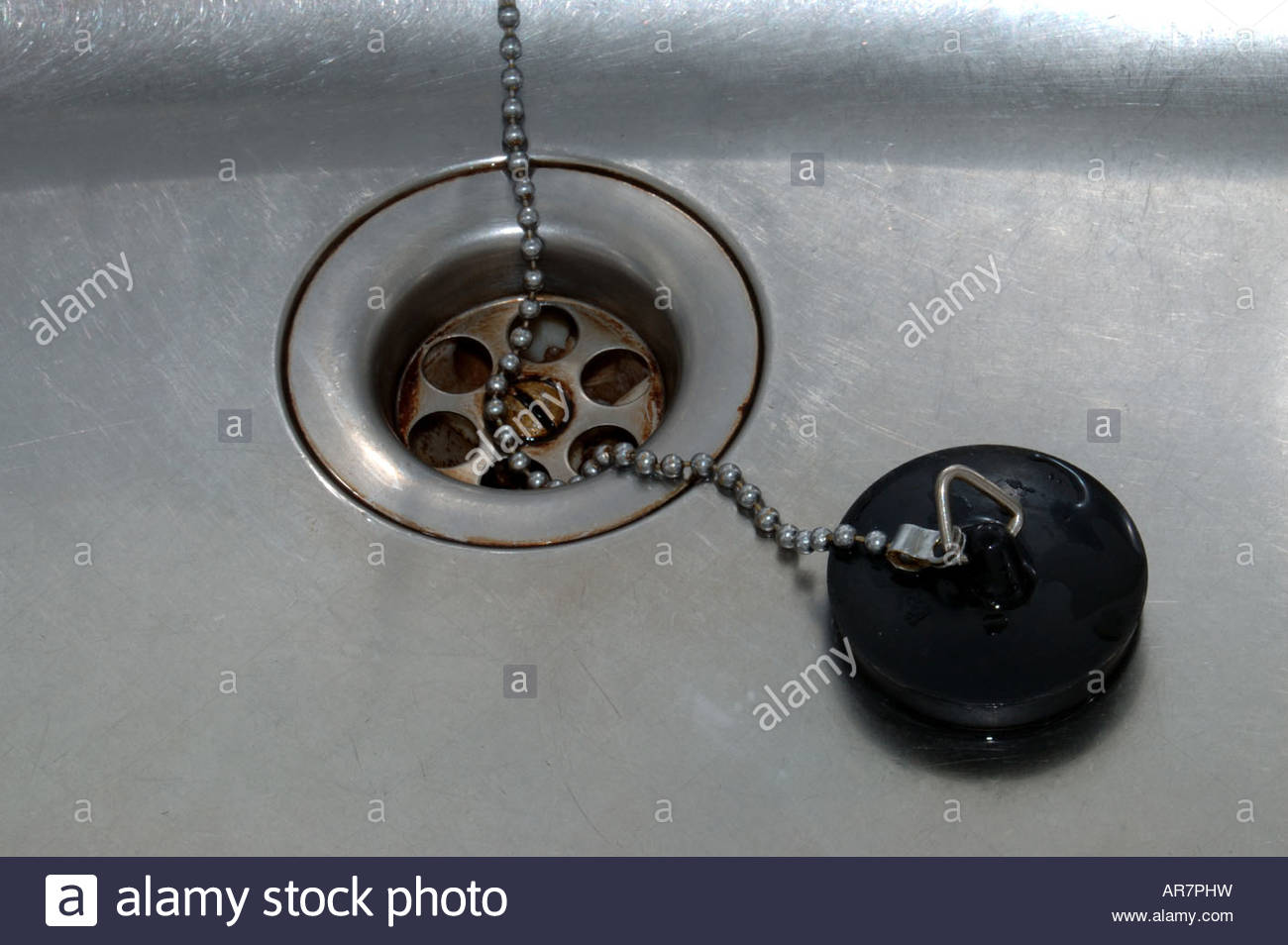 Kitchen sink plug and plughole a little bit dirty and - Kitchen sink plug ...