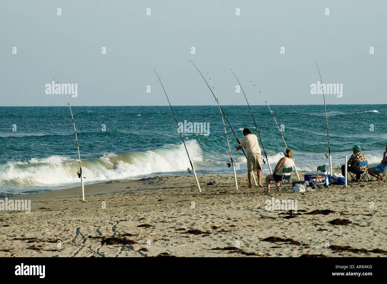 People fishing on the beach near sebastian inlet state for Sebastian inlet fishing report