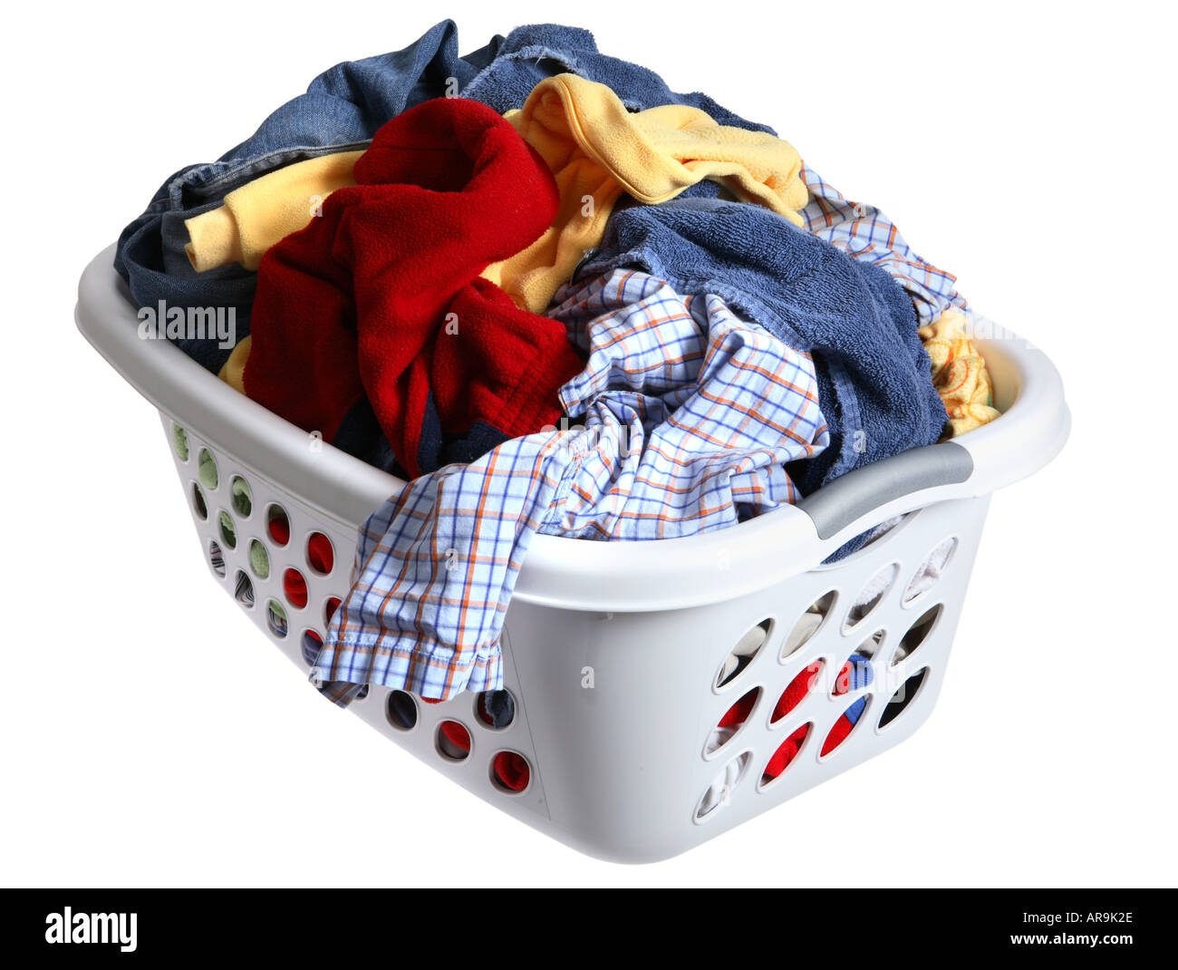 laundry basket full of dirty clothes stock image