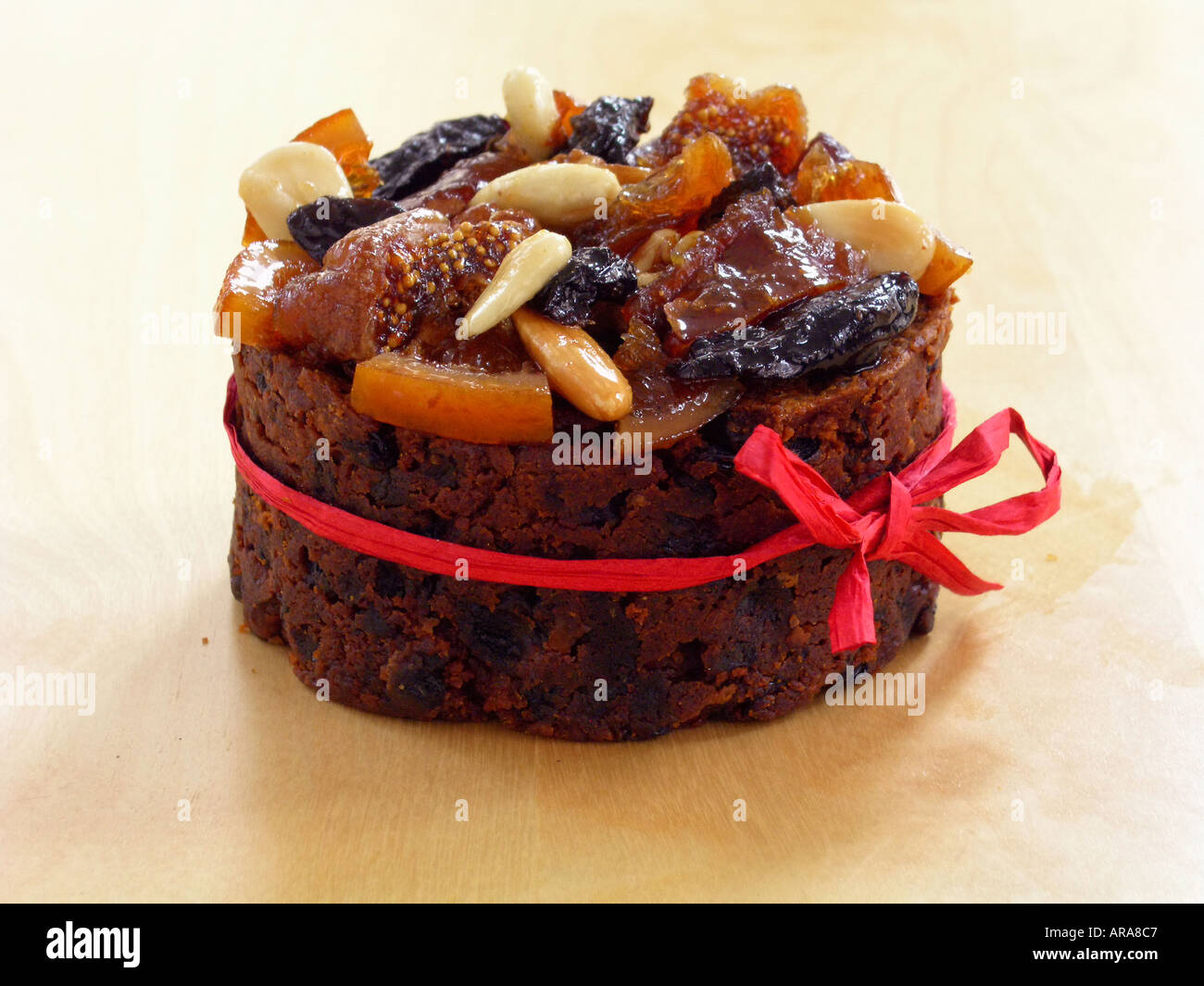 Fruit cake with glazed topping of nuts and dried fruit ...