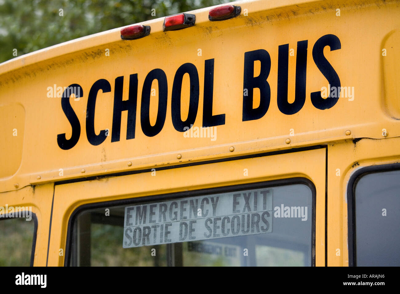 school bus and emergency exit sign on rear of vehicle