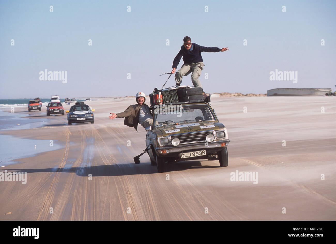Plymouth Dakar Rally Cars Race Along The Beach Side In Mauritania Car Surfing