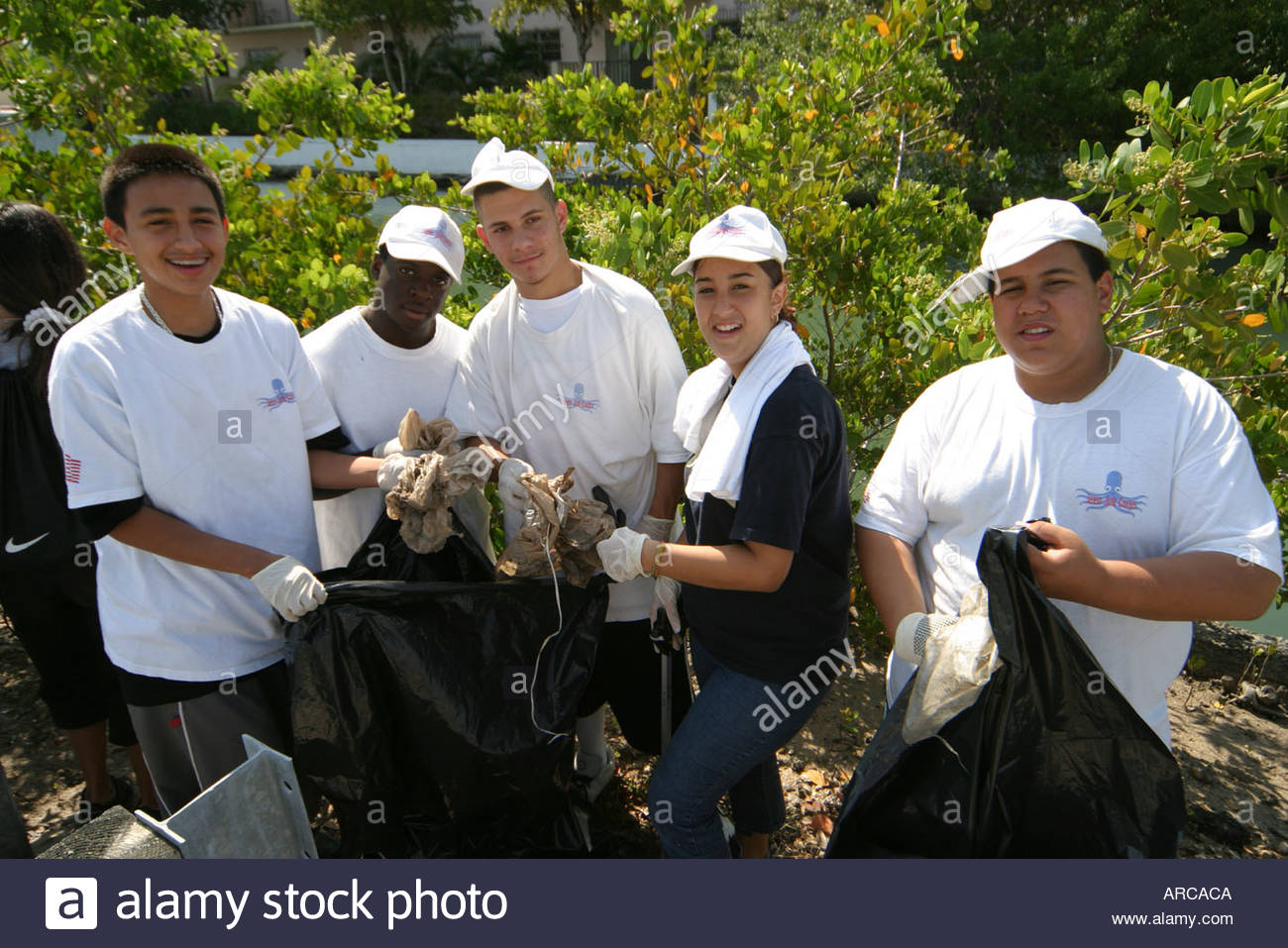 miami beach florida dade canal teen job corps students adults miami beach florida dade canal teen job corps students adults cleaning collecting trash pollution environment