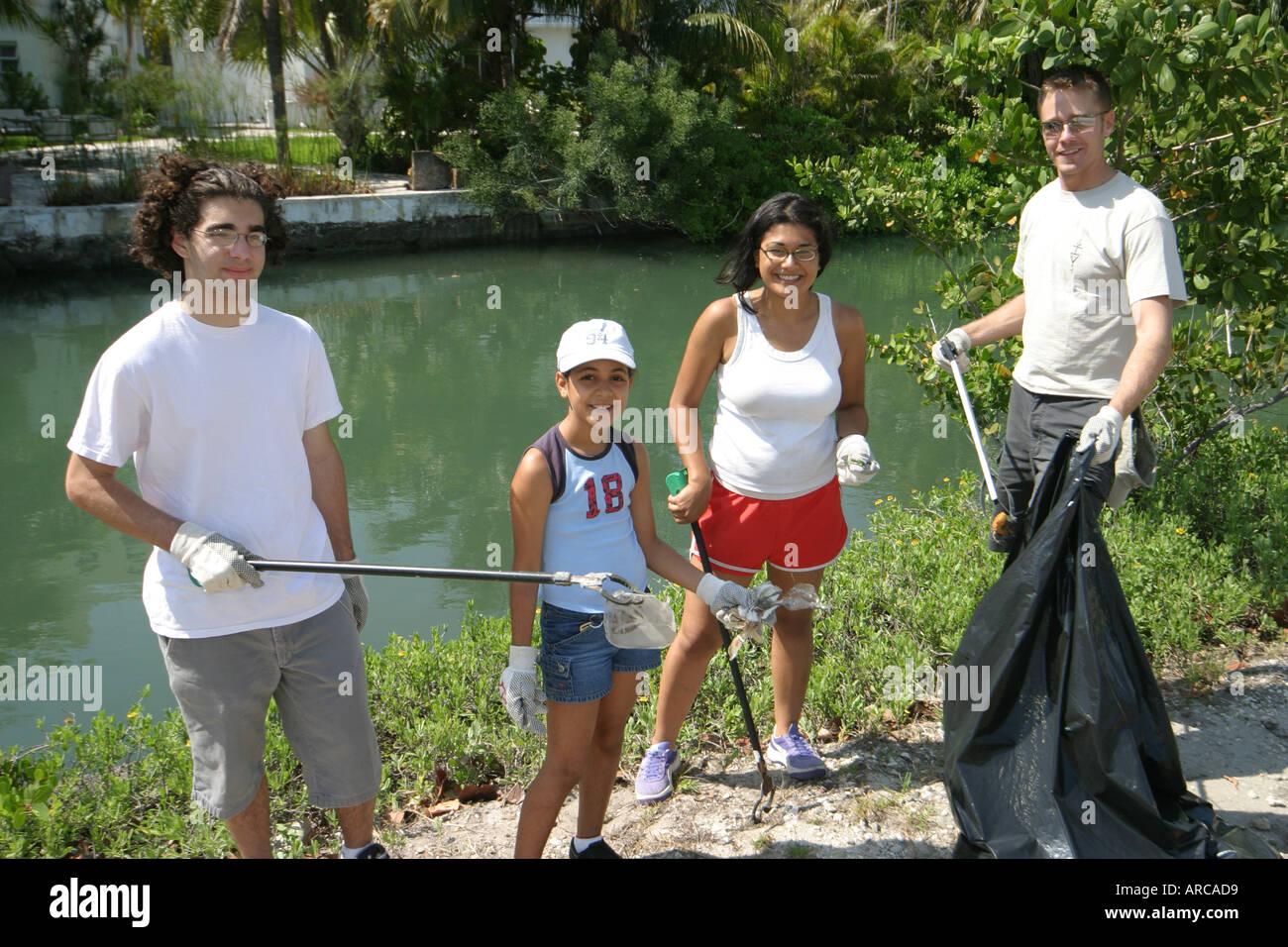 miami beach florida dade canal teen job corps students adults miami beach florida dade canal teen job corps students adults cleaning collecting trash pollution environment