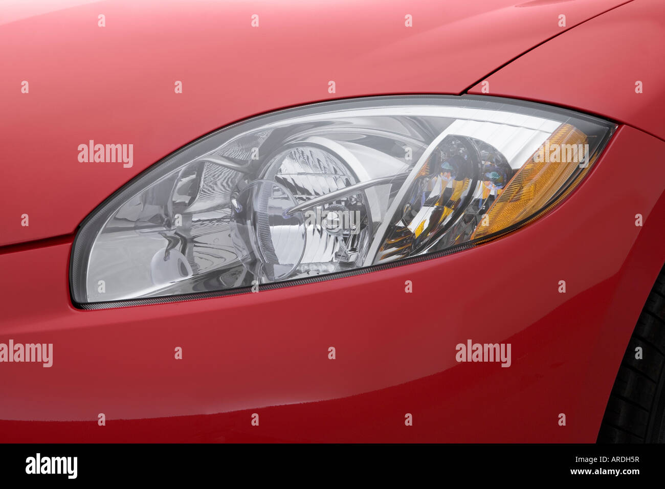 2007 mitsubishi eclipse spyder gt in red headlight stock image