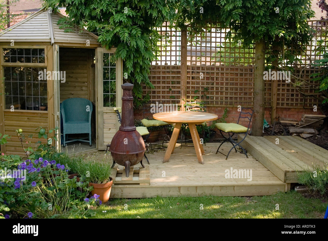 Small summer house with split level deck stock photo for Split level garden decking