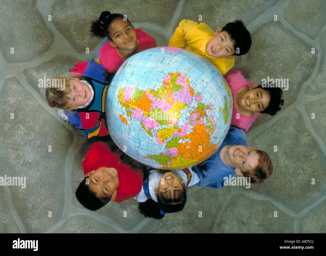 Pictures Of Kids Holding The Globe