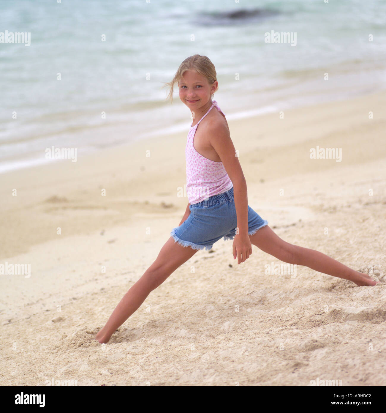 youngster girls Stock Photo - Young Girl on Beach at Moorea in Tahiti