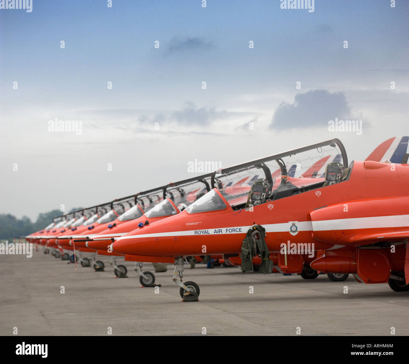 The Red Arrows RAF Formation Display Team Hawk Aircraft Parked Canopies Open Noses Aligned On Pad