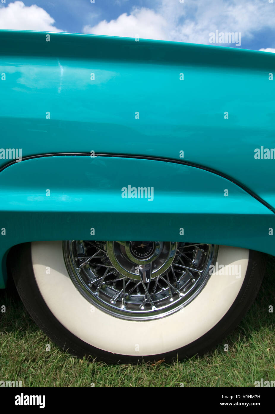 a close up of a turquoise ford thunderbird rear quarter white wall tyre tire