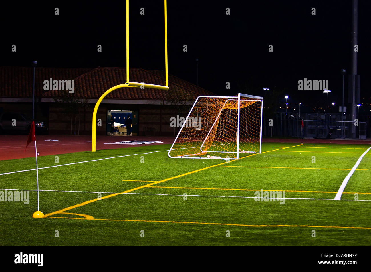 Empty high school soccer goal laid out on a football field ...