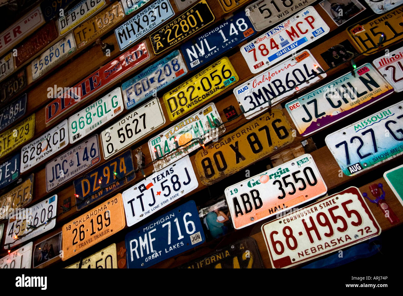 Old American license and number plates pictured covering the roof ...