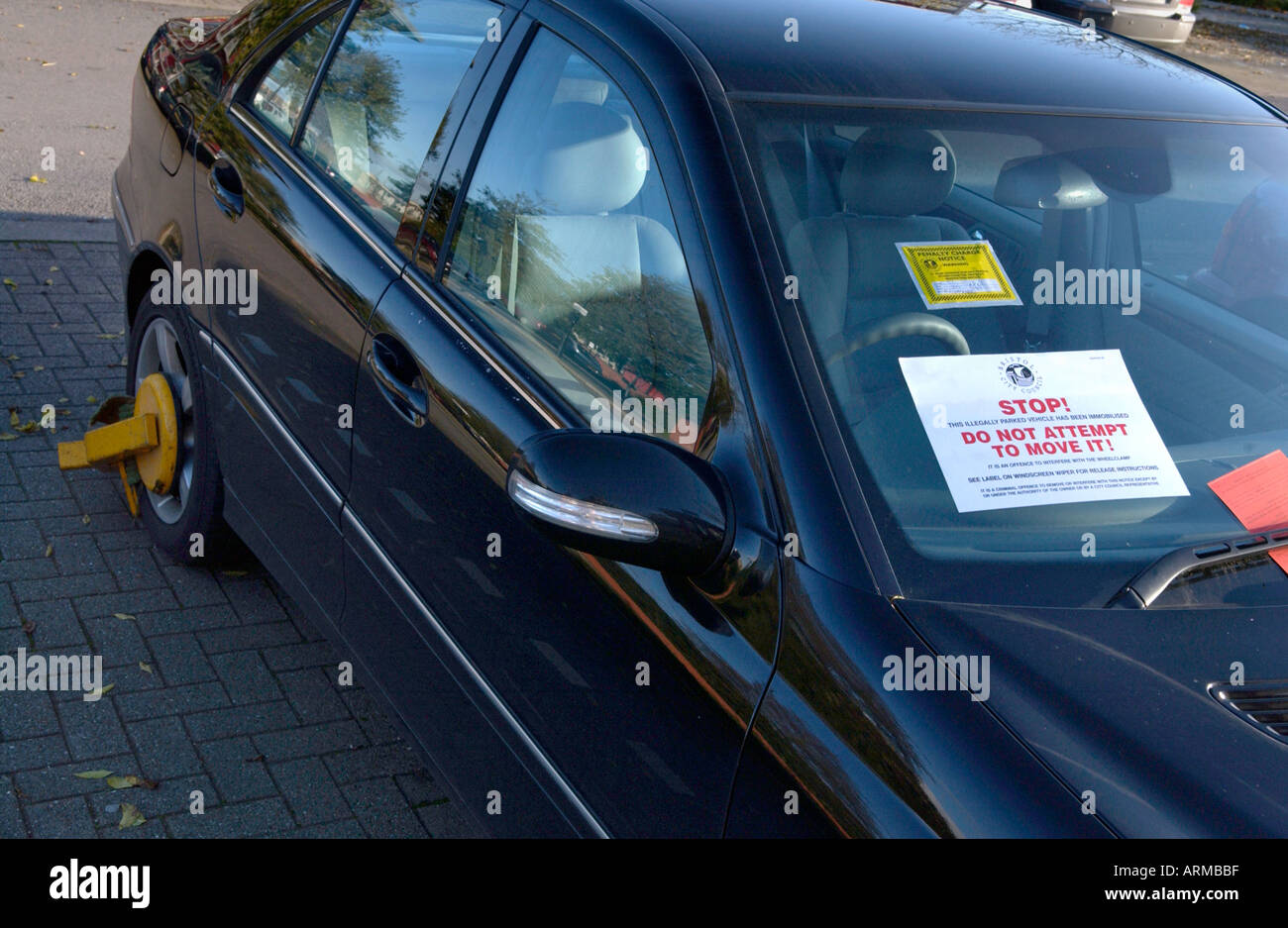 Car parking stickers design india - Illegally Parked Car With Parking Ticket Sticker And Penalty Notice On Windscreen Uk Stock Image