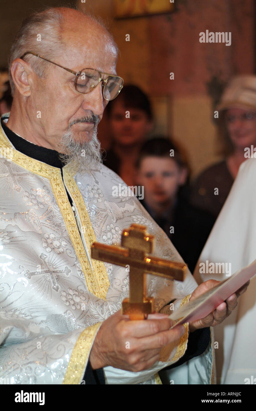 Orthodox Priest Taking A Reading As Part Of An Eastern Wedding Ceremony