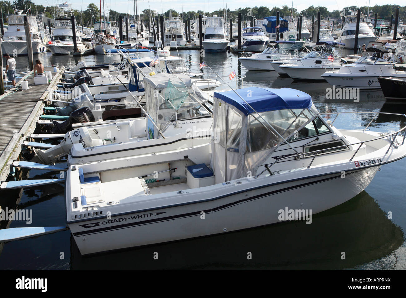 Line of small outboard motor fishing boats at dock at the for Fishing boat motor