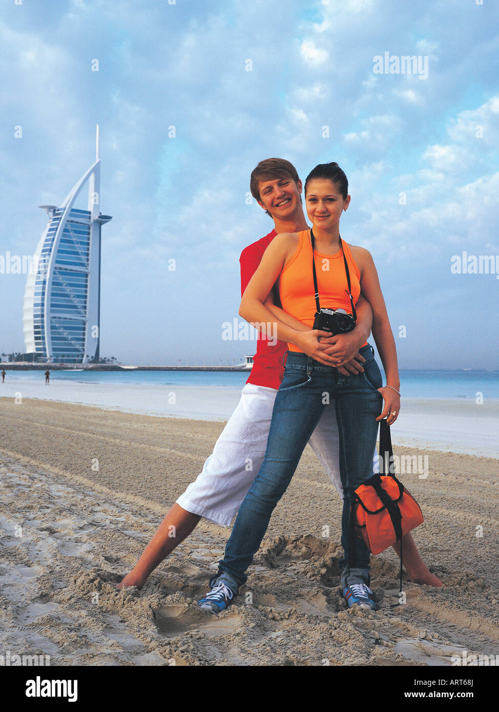 Western couple on the beach near burj al arab hotel in for Best hotels in dubai for couples