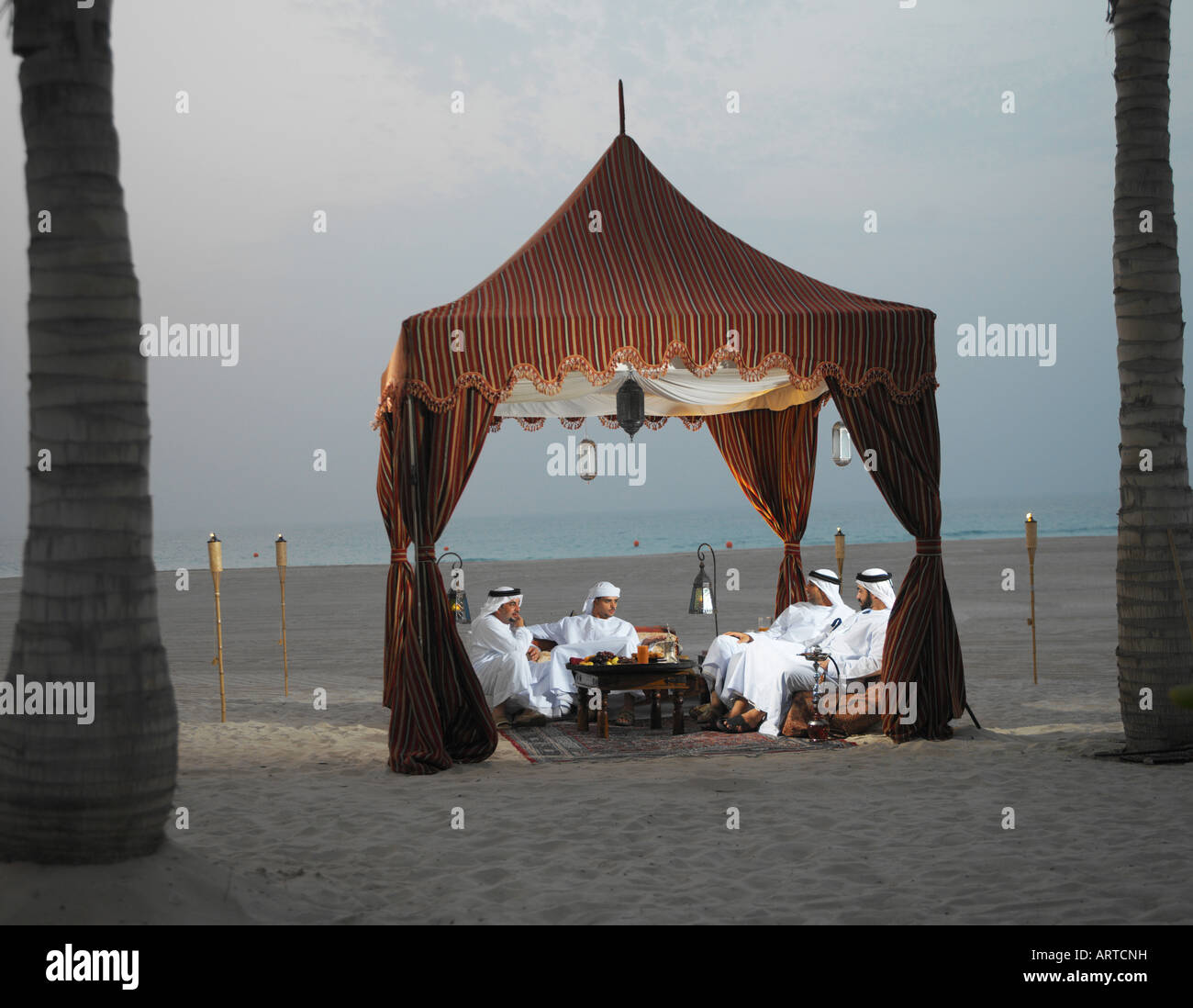 Ramadan Arab men sitting in Arabian tent for Iftar (fast-breaking meal after sunset & Ramadan: Arab men sitting in Arabian tent for Iftar (fast-breaking ...