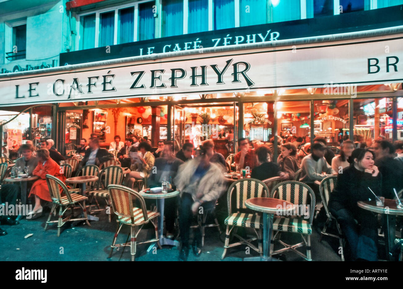 Crowded restaurant table - Paris France People On Terrace Of Le Caf Zephyr Crowded French Restaurant At