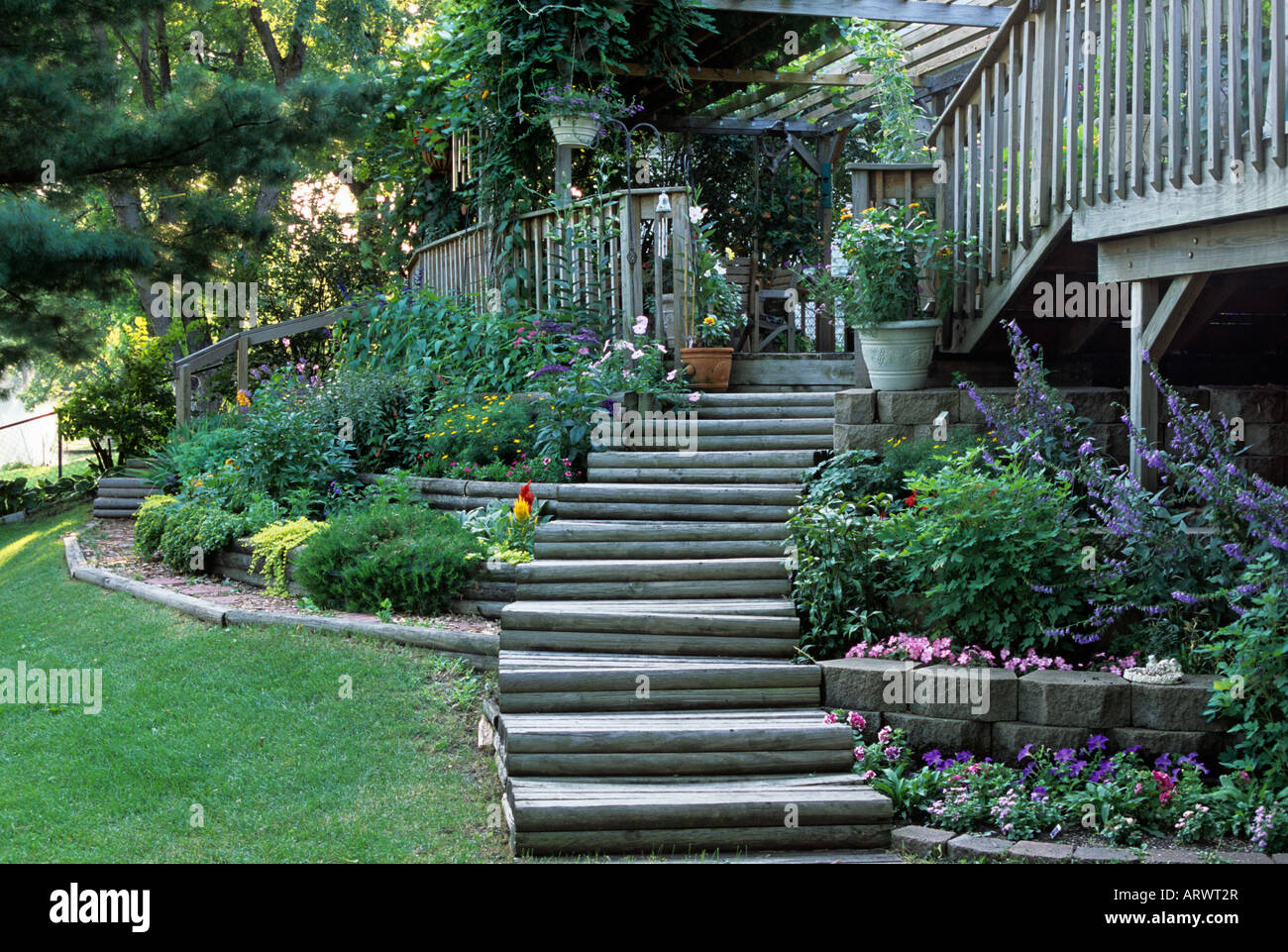 Uncategorized Terraced Gardens wood stairway through terraced gardens lead from deck to backyard of midwestern home summer