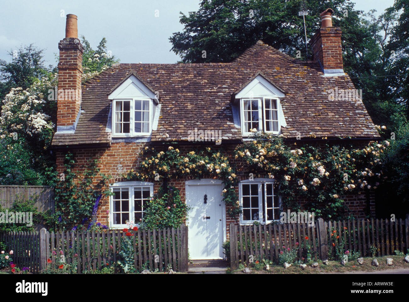 Traditional Brick Country Cottage With Dormer Windows Tile