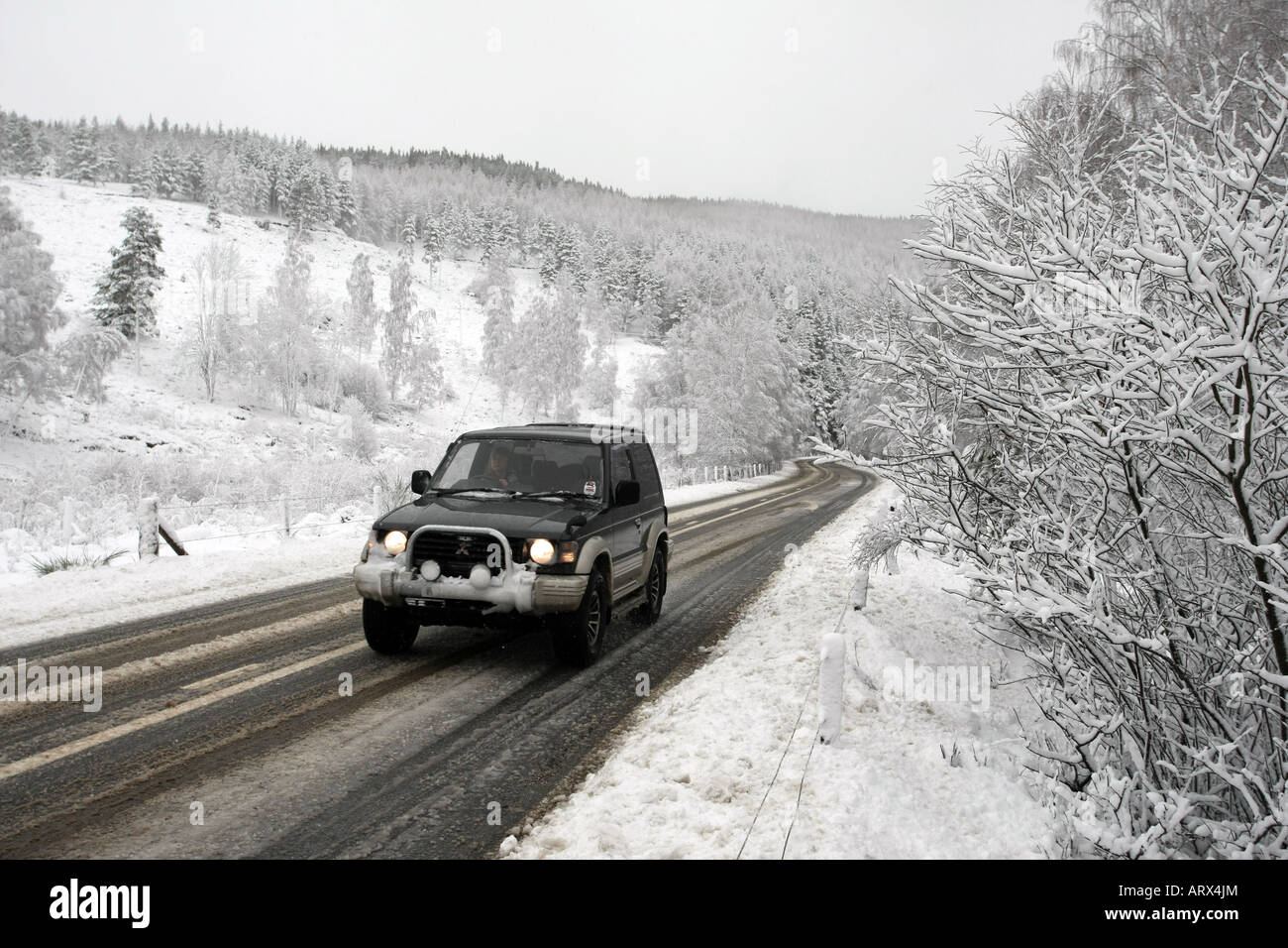 a four wheel drive 4x4 vehicle driving along a snow covered a93 road stock photo royalty free. Black Bedroom Furniture Sets. Home Design Ideas