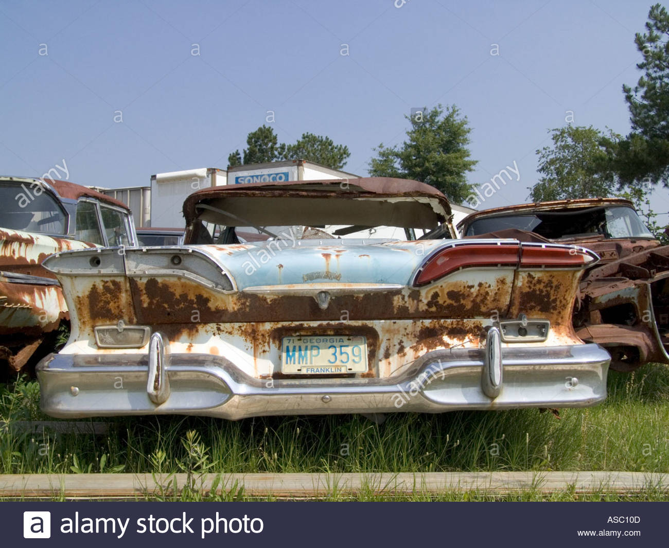 tail lights of classic cars sitting in a junkyard Stock Photo ...