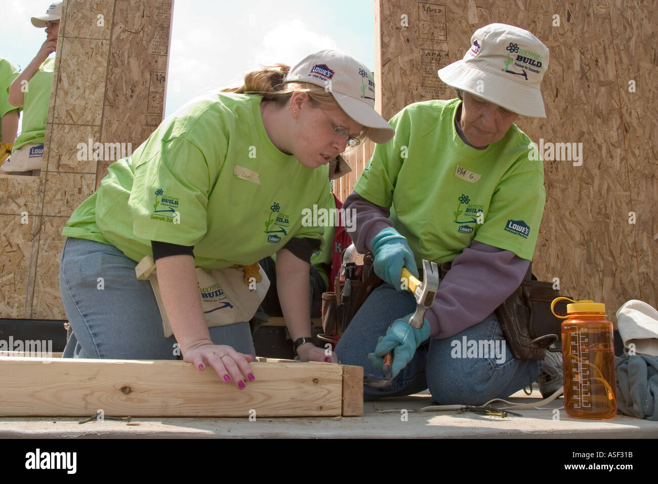 Women Volunteers Help Build House For Low Income Family Through Habitat For  Humanity