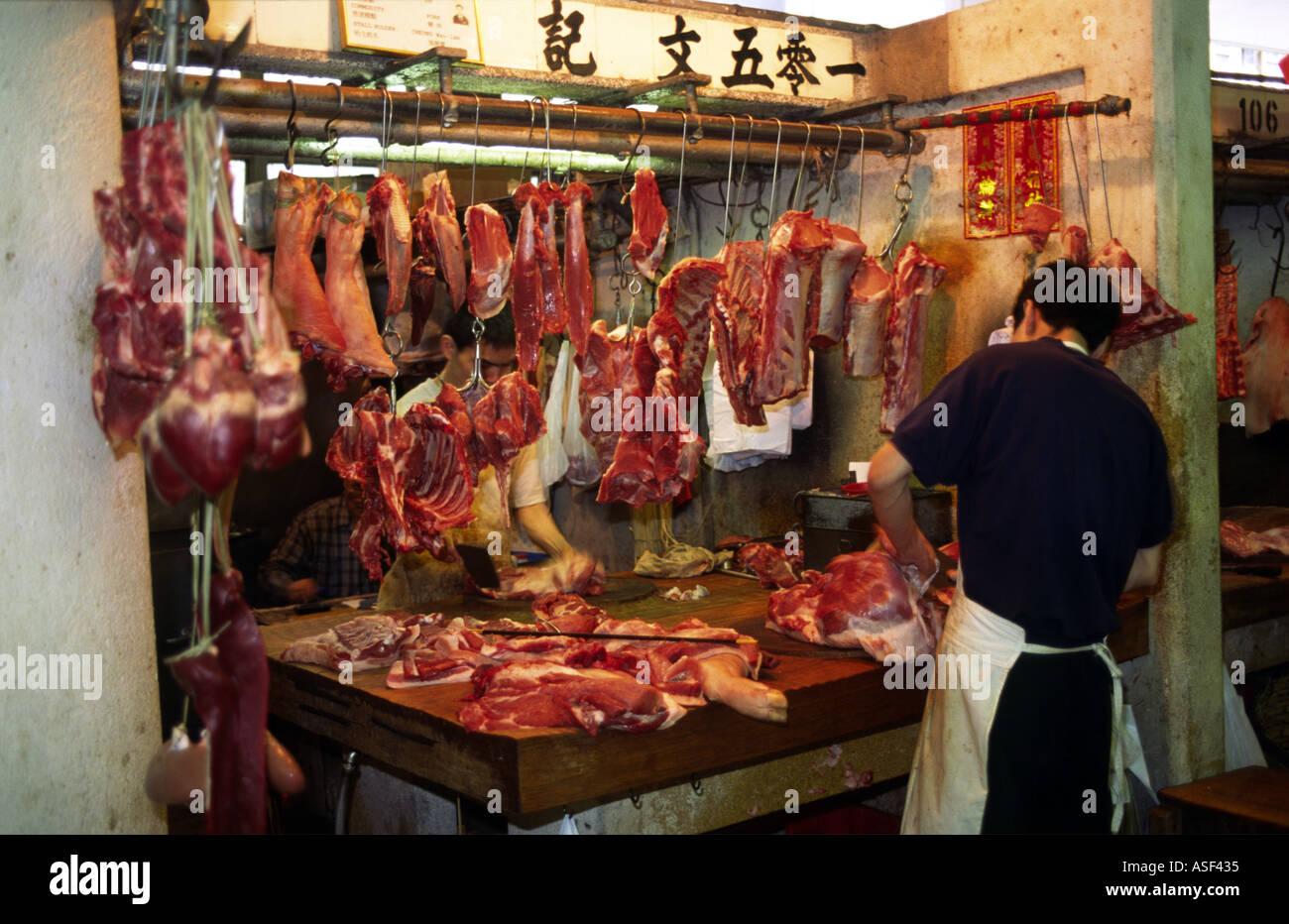 a butchers stall selling fresh meat at central market hong. Black Bedroom Furniture Sets. Home Design Ideas