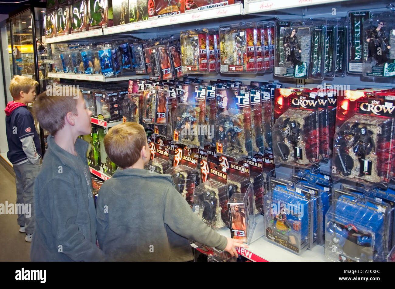 Toy Stores For Boys : Young boys shop for action figure toys in hamley s store