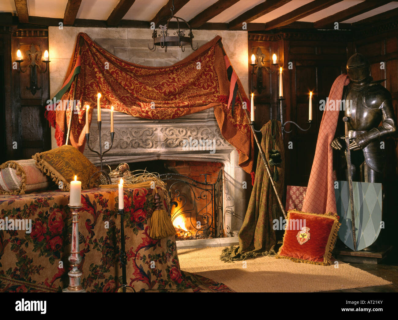 velvet drape above stone fireplace in tudor style sitting room