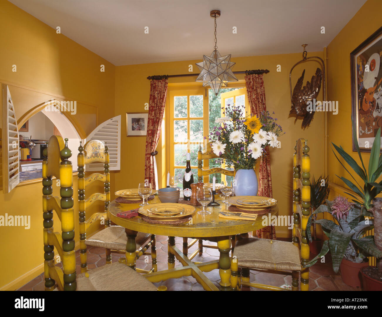 Painted Yellow Chairs And Table In Bright Dining Room With Serving Hatch The Wall