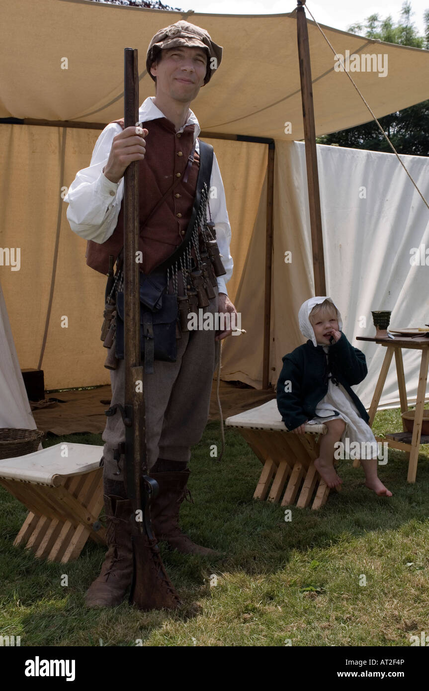 English civil war soldier and daughter in a field tent played during a sealed knot reenactment & English civil war soldier and daughter in a field tent played ...