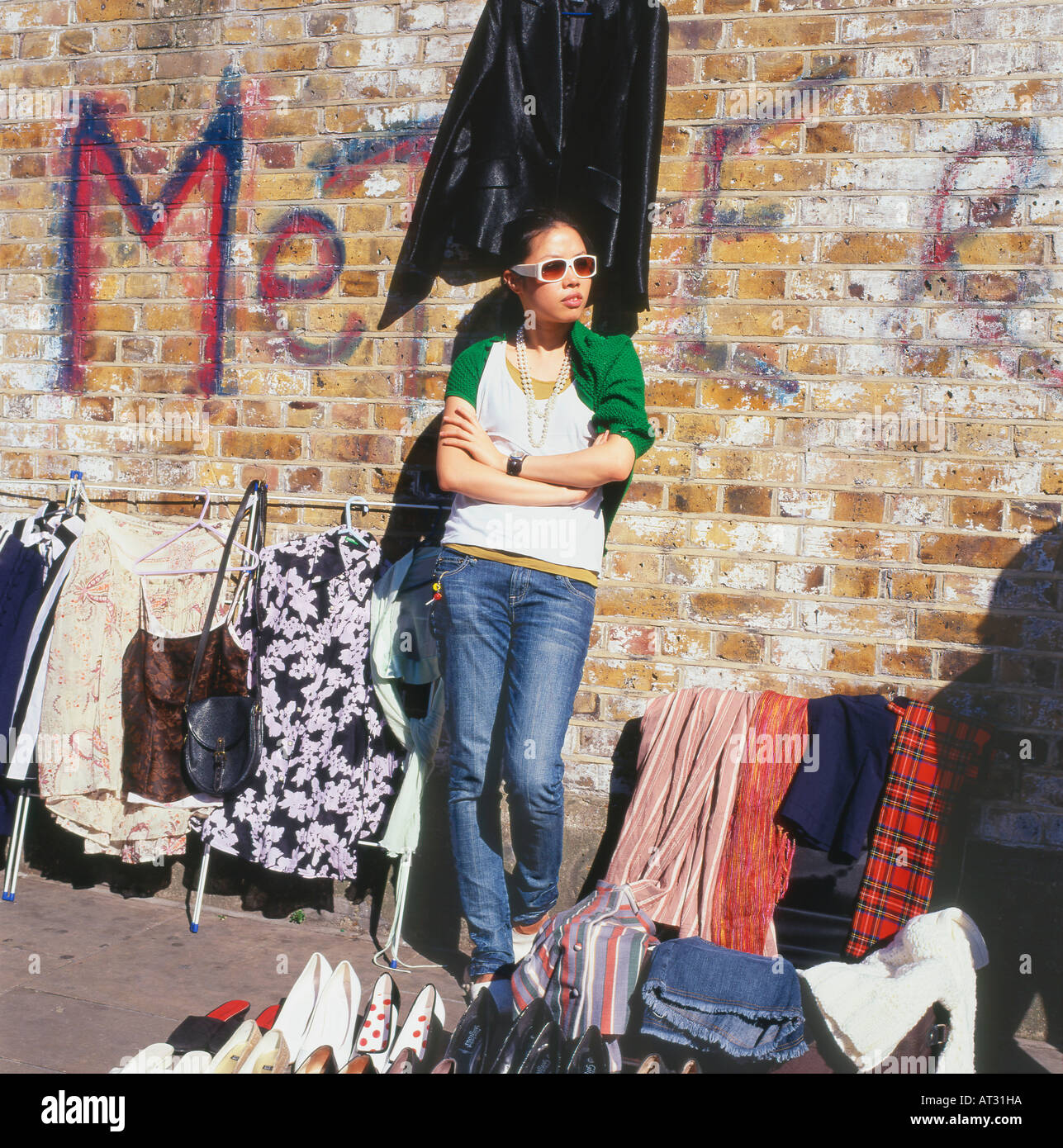 A Chinese street trader selling old clothes in summer at Brick ...