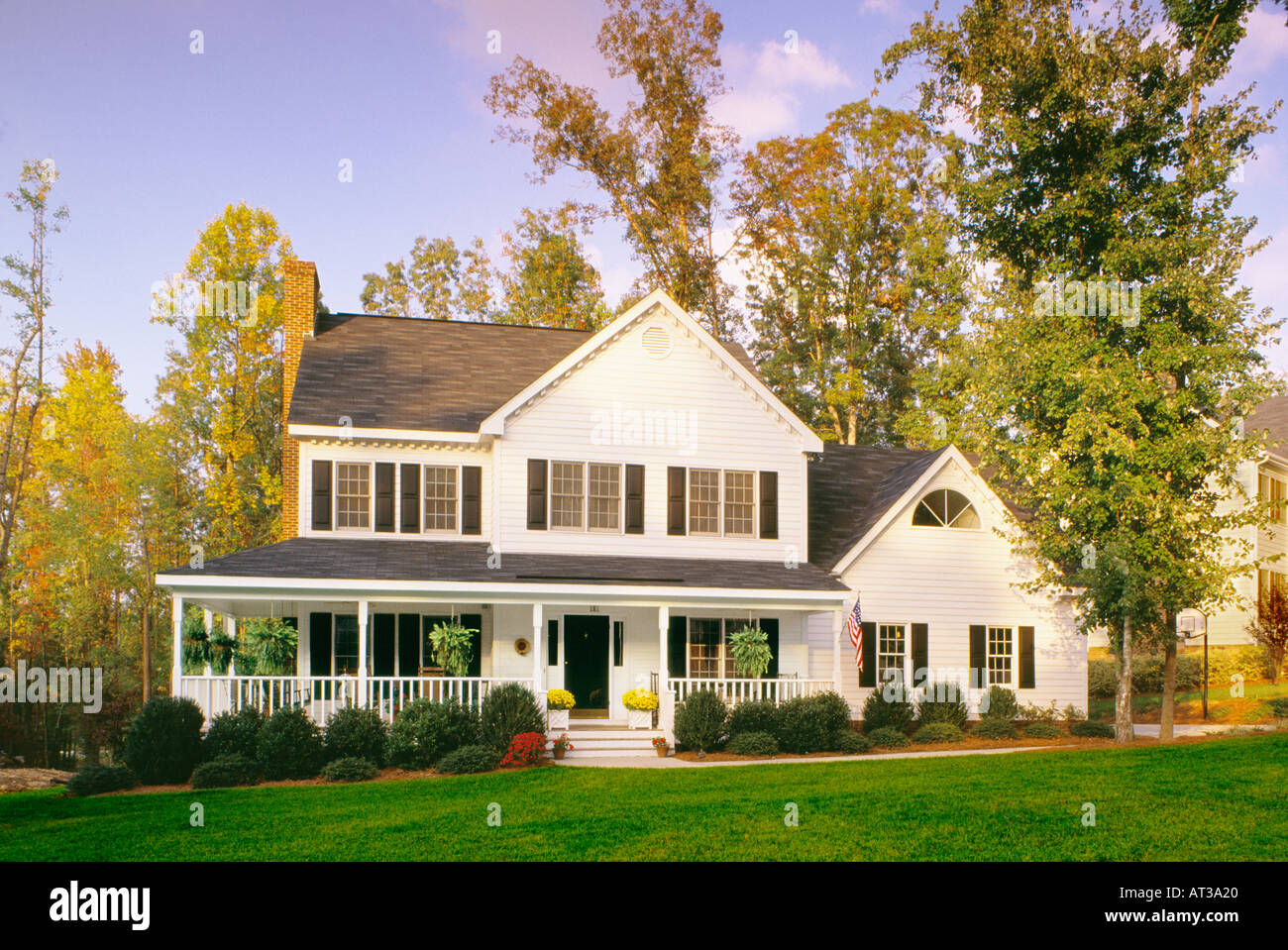 Large white house with black trim and a large front porch ...