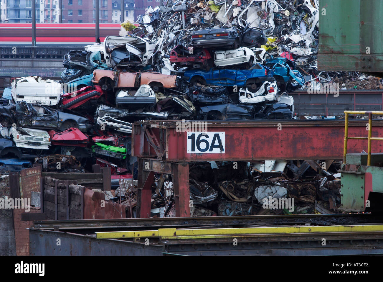 A piled up heap of old trash cars in the eastern harbor of ...