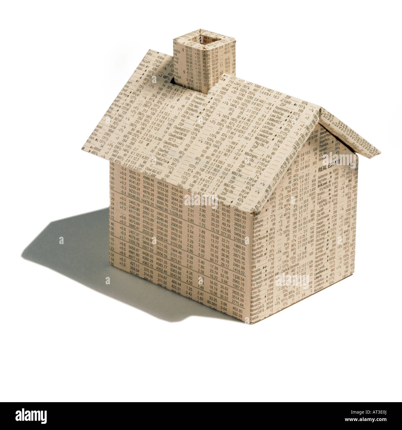 an origami house made from a financial newspaper stock