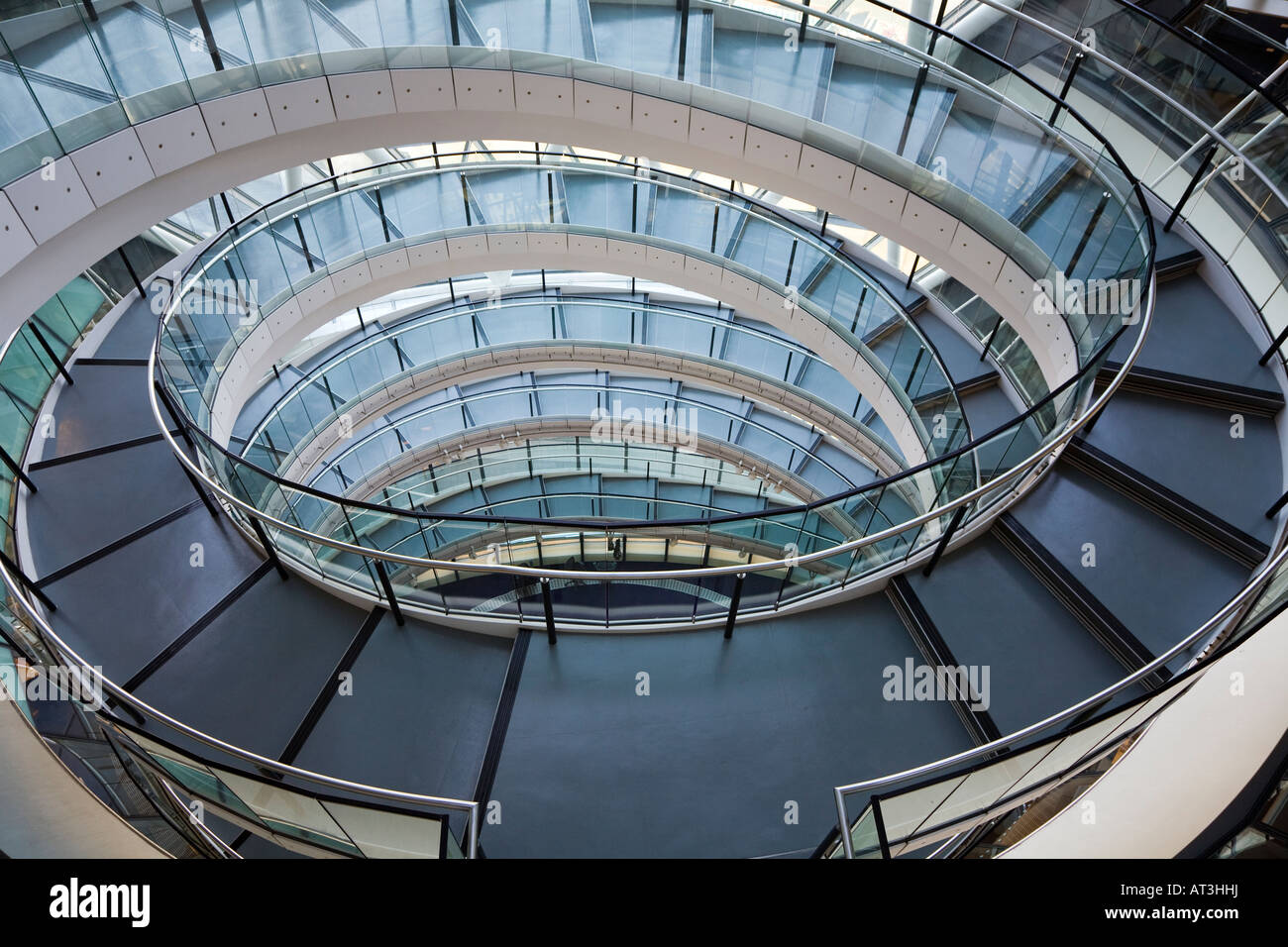 Spiral stairs in norman foster landmark building city hall for Square spiral staircase plans hall